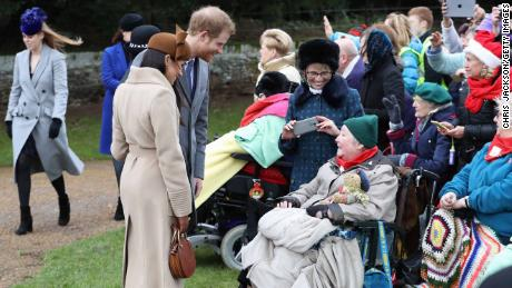Meghan Markle and Prince Harry meet well-wishers outside the church.