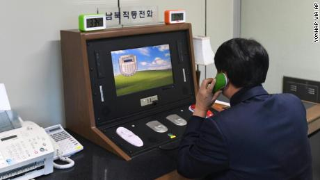 A South Korean official communicates with a North Korean officer on the dedicated communications hotline at the border village of Panmunjom in Paju, South Korea, on Wednesday.