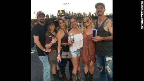 Just hours before the shooting, Rachel Sheppard, third from left, and Alaina Kelly, center in white, enjoyed the festival with thousands of other country music fans.