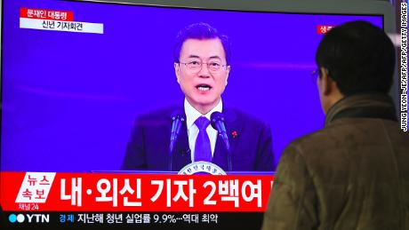 A man watches a television screen broadcasting live footage of South Korean President Moon Jae-In's New Year's speech, at a railway station in Seoul on January 10, 2018.