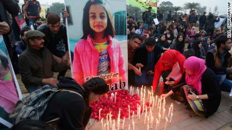 Pakistani students light candles during a protest rally to condemn the rape and killing of Zainab Ansari, an 8-year-old girl.