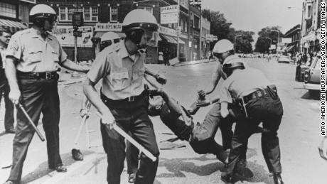 A man is carried away by police during riots in Baltimore, Maryland, in 1968.