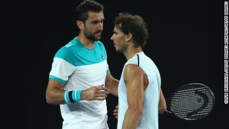 Rafael Nadal and Marin Cilic exchange a handshake.