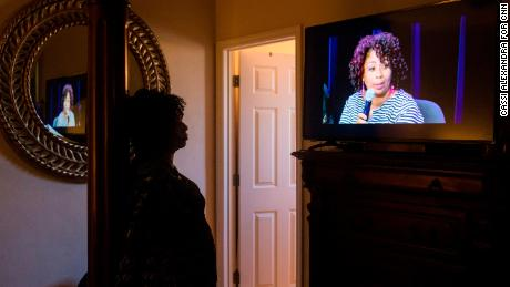 Johnson has become a public speaker on child marriage. Here, she watches a video of herself at a recent panel discussion sponsored by the Tahirih Justice Center.