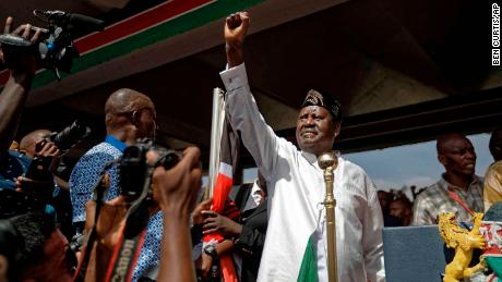 Opposition leader Raila Odinga holds a Bible aloft after swearing an oath during a mock inauguration ceremony at Uhuru Park in downtown Nairobi on Tuesday.