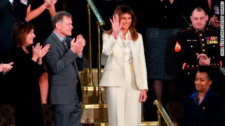 The first lady's cream suit, kente cloth and purple ribbons: What the SOTU fashion choices meant
