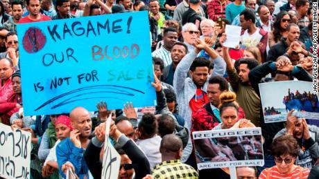 African migrants demonstrate outside the Embassy of Rwanda in the Israeli city of Herzliya on February 7.