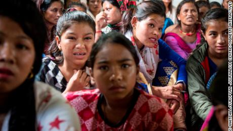 Nepalese Christians react to graphic pictures of aborted fetuses during a lecture by Soman Rai.