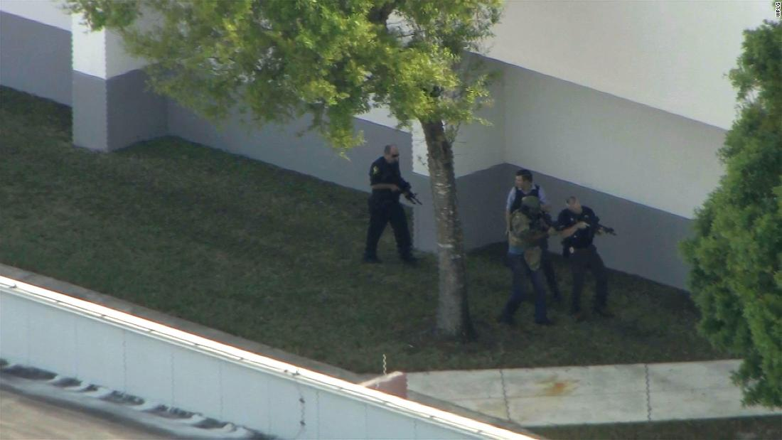 Police officers surveil the exterior of the school while the shooting was active.