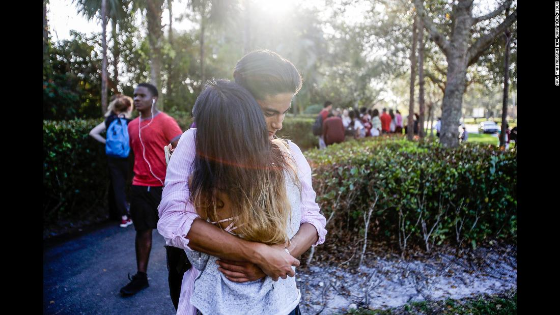 Lavinia Zapata embraces her son, Jorge, after he was evacuated from the school.