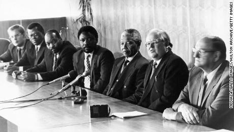 Former President Nelson Mandela with Cyril Ramaphosa and Jacob Zuma.
