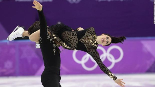 Canadian ice dancers Tessa Virtue and Scott Moir broke their own world-record score to take the lead after day one of the Olympic ice dancing competition. The duo won gold in 2010 and silver in 2014.