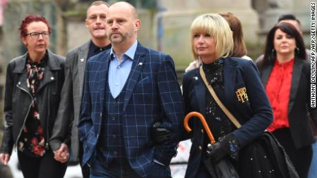 Ex-Manchester City youth football player Chris Unsworth (C) arrives at court on Monday.