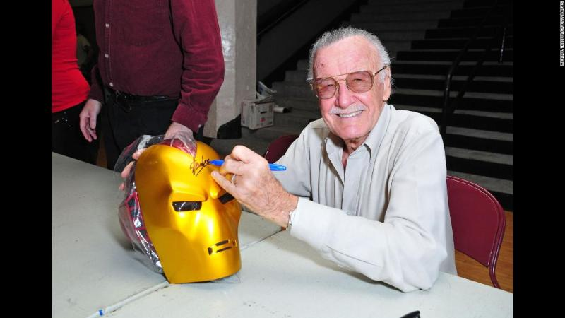 """Lee signs an """"Iron Man"""" mask in 2008."""