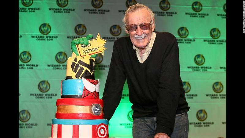 Lee is presented with a birthday cake for his 91st birthday in 2013.