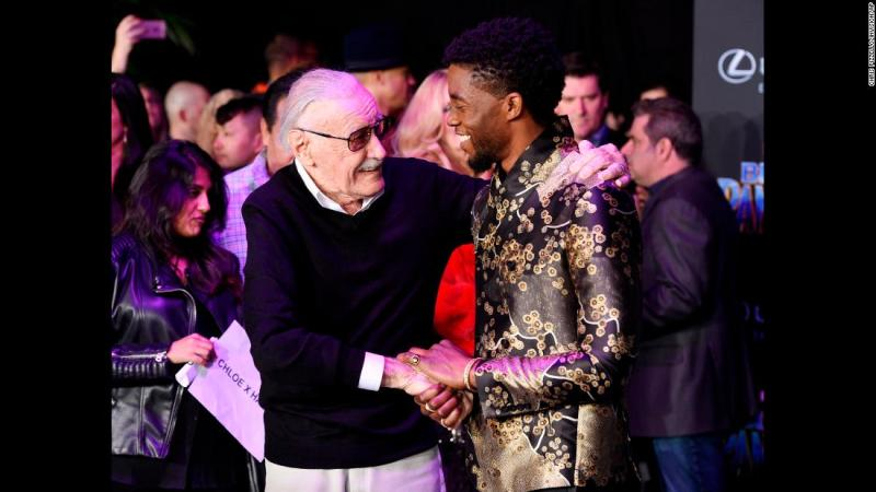 """Lee shakes hands with """"Black Panther"""" star Chadwick Boseman at the film's premiere in January 2018."""