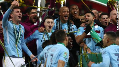 Manchester City celebrate after winning the Carabao Cup Final 3-0 against Arsenal at Wembley Stadium.