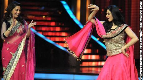 "Sridevi and fellow Bollywood star Madhuri Dixit attend the final of the hit TV show ""Jhalak Dikhala Jaa Season 5,"" in Mumbai in 2012."