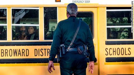 Massacre victim's brother returns to school