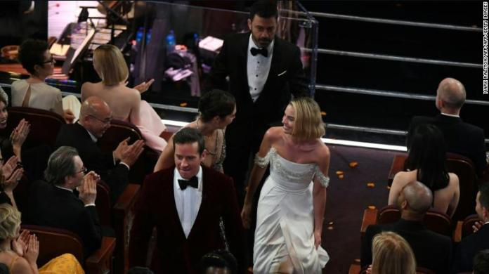 Comedian Jimmy Kimmel (C), Australian actress Margot Robbie (R), Israeli actress Gal Gadot (C,L) and actor Armie Hammer interact with movie goers at the Chinese theatre during the 90th Annual Academy Awards show on March 4, 2018 in Hollywood, California.