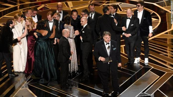 """Guillermo del Toro and the cast and crew of """"The Shape of Water"""" accept the award for best picture at the Oscars on Sunday, March 4, 2018"""