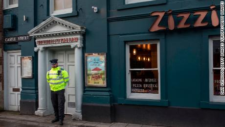 A police officer stands outside Zizzi restaurant in Salisbury, close to where the Skripals were found.
