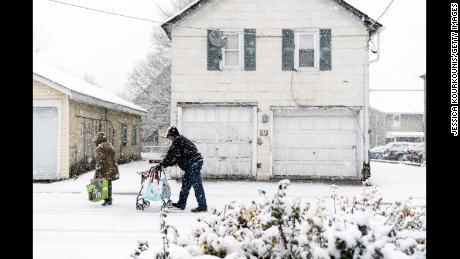 People make their way through snow Wednesday in Quakertown, Pennsylvania, north of Philadelphia.