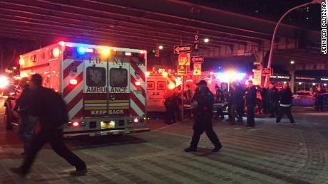 First responders carry a person to an ambulance after the helicopter crashed into the East River.