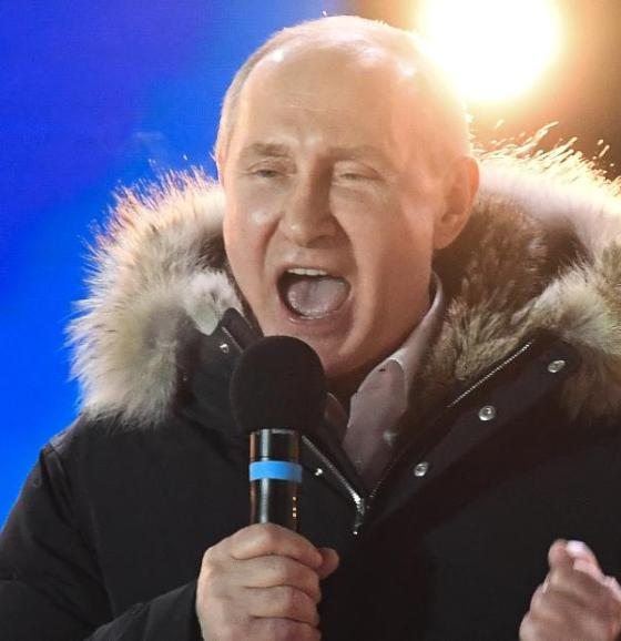 Putin addresses the crowd during a rally and concert in Moscow on Sunday night.