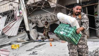 Fighters loot shops after seizing control of Afrin from Kurdish forces on Sunday.