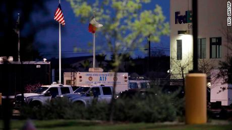 An ATF vehicle sits at a FedEx sorting center where a package exploded Tuesday in Schertz, Texas.
