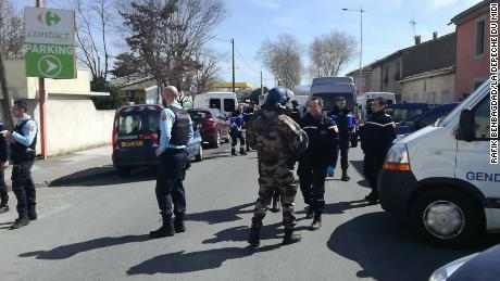 Police respond to the supermarket siege Friday in Trèbes.