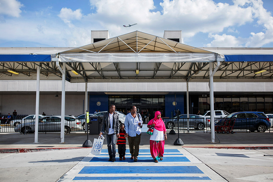Abdalla, Habibo and their youngest son, Ibrahim, walk with Ramadhan outside the Atlanta airport after reuniting with him there in July. (Melissa Golden/Redux for CNN)