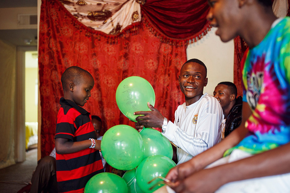 Abdalla's children filled balloons with money to welcome their oldest brother, Ramadhan, to the United States. The day before, the family panicked when they heard fireworks for the first time. (Melissa Golden/Redux for CNN)