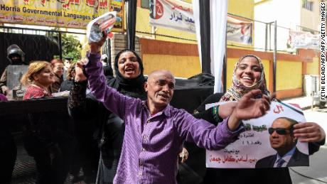 Sisi supporters pictured outside a polling station in Cairo.