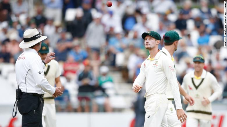 Cameron Bancroft (right) throws the ball to umpire Richard Illingworth.