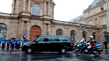 Republican Guards escort the hearse transporting the coffin of  Lt. Col.  Arnaud Beltrame.