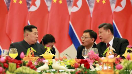 Kim Jong Un, left, and Xi Jinping, right, are seen at a banquet in Beijing in March, in this photo released by North Korean state media.