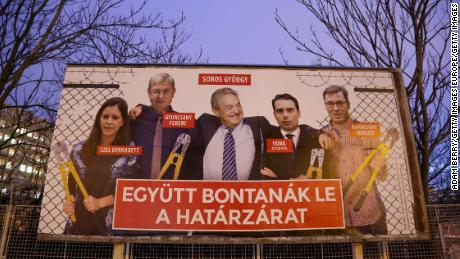 """A Fidesz billboard features Soros among opposition figures and says, """"They would dismantle the border fence together."""""""
