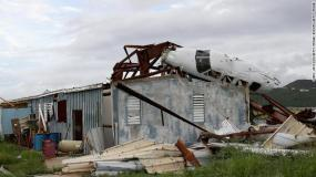 The wreckage of a plane lies on the roof of a destroyed building in Tortola, British Virgin Islands.