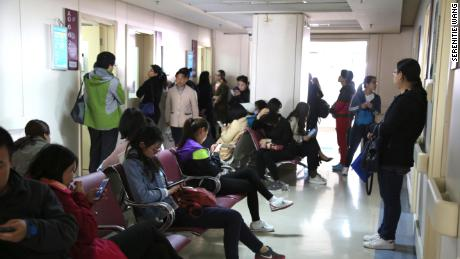 A crowd waits at a government-run reproductive health center.