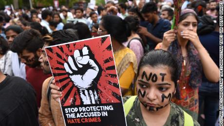 Protesters take part in the 'Not In My Name' protest against the Kathua and Unnao rape cases, in New Dehli on April 15.