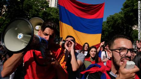 People march with Armenian flags as they commemorate the 103rd anniversary of the mass killings of Armenians by Ottoman forces on April 24, 2018, in Marseille, France.