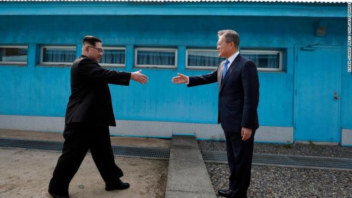 North Korean Leader Kim Jong Un (left) and South Korean President Moon Jae-in (right) shake hands over the military demarcation line that divides the demilitarized zone upon meeting for the inter-Korean Summit on Friday.