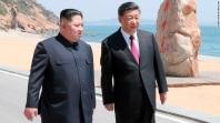 Xi and Kim during a stroll at their meeting in Dalian, China.
