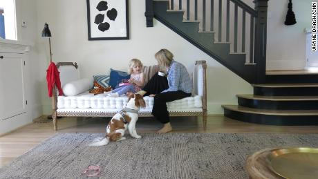Erika Zak says her will to live is motivated by her daughter, Loïe. Here, they play on the couch as the family dog, Maddie, watches.