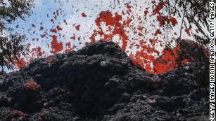 A fissure spews lava in Pahoa, Hawaii, after a massive eruption of the Kilauea volcano.