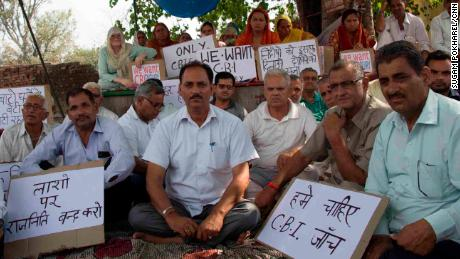 Hindu Ekta Manch's president Vijay Kumar Sharma (center, white shirt). Members of the activist group maintain that the accused men are innocent and are calling for an independent  investigation.