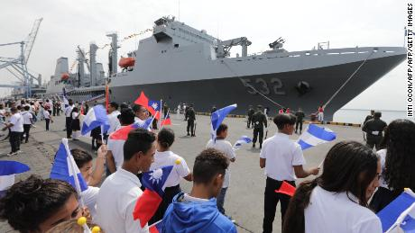 Nicaraguan students wave Taiwanese flags to welcome three Taiwanese Navy warships at Corinto port, some 149 kilometers northwest of Managua, on April 9, 2018.