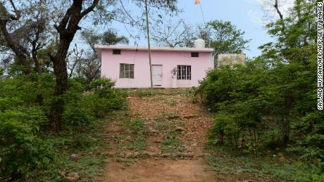 The path leading to the small nondescript Hindu temple, where it is alleged the eight-year-old girl was held captive for five days.